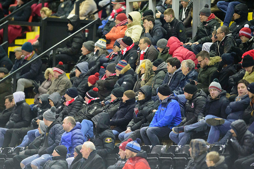 Lincoln City fans watch their team in action<br /> <br /> Photographer Andrew Vaughan/CameraSport<br /> <br /> The EFL Sky Bet League One - Lincoln City v Milton Keynes Dons - Tuesday 11th February 2020 - LNER Stadium - Lincoln<br /> <br /> World Copyright © 2020 CameraSport. All rights reserved. 43 Linden Ave. Countesthorpe. Leicester. England. LE8 5PG - Tel: +44 (0) 116 277 4147 - admin@camerasport.com - www.camerasport.com