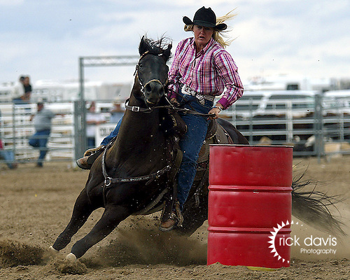 Jaymee Martin turns the barrels with a time of 17.76 seconds during action at the Southeast Weld County CPRA Rodeo in Keenesburg on August 12, 2006.