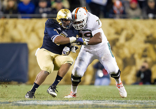 October 06, 2012:  Notre Dame defensive end Stephon Tuitt (7) and Miami offensive lineman Malcolm Bunche (79) battle at the line of scrimmage during NCAA Football game action between the Notre Dame Fighting Irish and the Miami Hurricanes at Soldier Field in Chicago, Illinois.  Notre Dame defeated Miami 41-3.