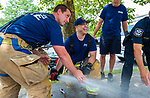 WATERBURY,  CT-071919JS12--  Waterbury firefighters  Erik Bellagamba, left, and Joel Rodriguez, with Engine 7 on Walnut Street, open a fire hydrant in Berkeley Heights to allow residents to cool themselves on an oppressively hot Saturday afternoon during a block party. <br /> Jim Shannon Republican American