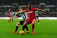 Matt Ritchie of Newcastle United battles with Jordan Ayew of Swansea City during Newcastle United vs Swansea City, Premier League Football at St. James' Park on 13th January 2018