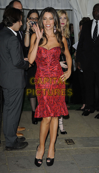 Sofia Vergara.The Glamour Women Of The Year Awards 2012, Berkeley Square Gardens, Berkeley Square, London, England..May 29th, 2012.full length red strapless dress viagra hand on hip ruched waving .CAP/CAN.©Can Nguyen/Capital Pictures.