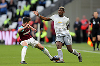 Declan Rice of West Ham United and Paul Pogba of Manchester United during West Ham United vs Manchester United, Premier League Football at The London Stadium on 10th May 2018
