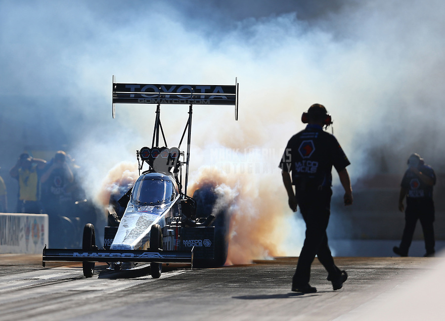 Sep 18, 2015; Concord, NC, USA; NHRA top fuel driver Antron Brown during qualifying for the Carolina Nationals at zMax Dragway. Mandatory Credit: Mark J. Rebilas-USA TODAY Sports