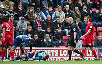Garry Thompson of Wycombe Wanderers as Orient players protest Tom Parkes (2nd left) of Leyton Orient sending off during the Sky Bet League 2 match between Leyton Orient and Wycombe Wanderers at the Matchroom Stadium, London, England on 1 April 2017. Photo by Andy Rowland.