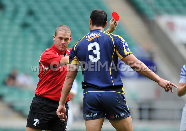 Jordan Smiler is shown a red card for a tip tackle. World Club 7s Cup quarter-final between ACT Brumbies and VVA Saracens Moscow Region on August 18, 2013 at Twickenham Stadium in London, England. Photo by: Patrick Khachfe / Onside Images