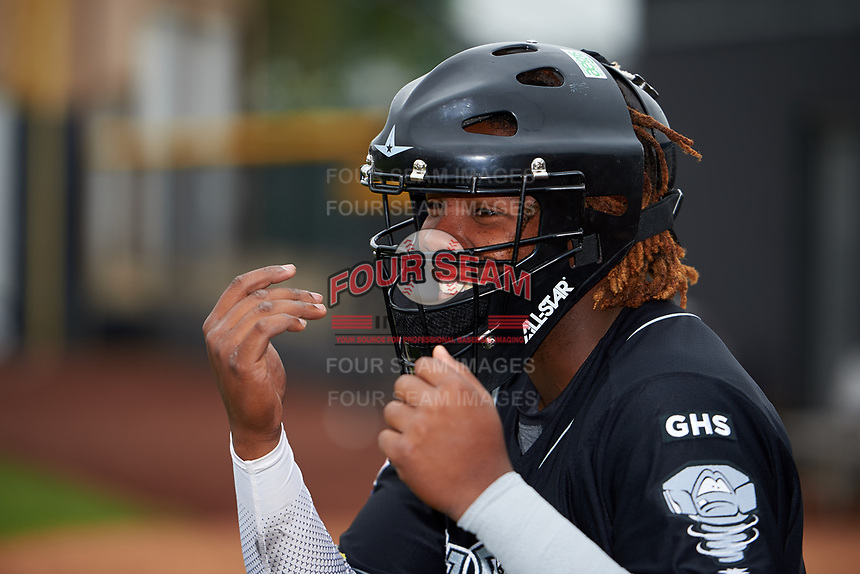 Lansing Lugnuts Vladimir Guerrero Jr. (27) wears a catcher's mask and jokes around with a teammate before a game against the Clinton LumberKings on May 9, 2017 at Ashford University Field in Clinton, Iowa.  Lansing defeated Clinton 11-6.  (Mike Janes/Four Seam Images)