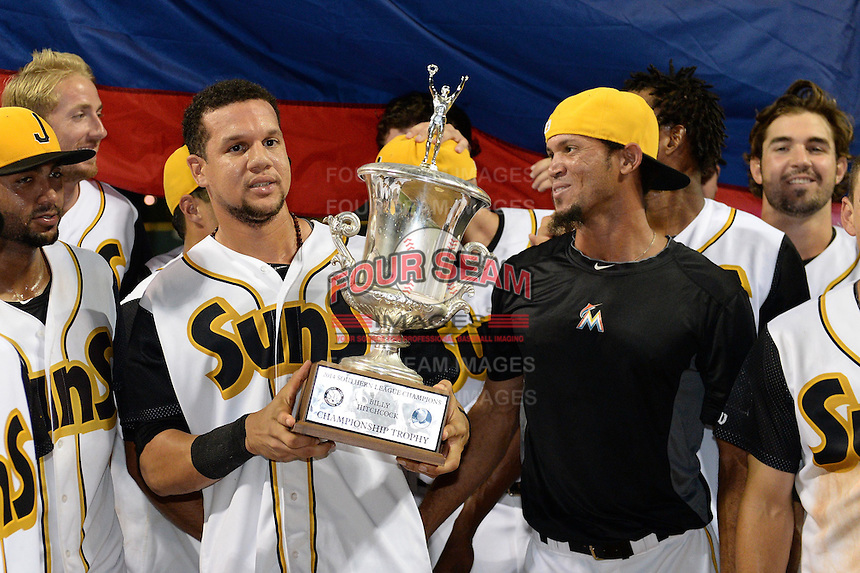 Jacksonville Suns Viosergy Rosa (44) holds the trophy as Jheyson Manzueta looks on after game three of the Southern League Championship Series against the Chattanooga Lookouts on September 12, 2014 at Bragan Field in Jacksonville, Florida.  Jacksonville defeated Chattanooga 6-1 to sweep three games to none.  (Mike Janes/Four Seam Images)