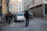 Press photographers reporting during the storm of the entrance of the Ministry of Economy. The building is attacked by a group of rioters, some of whom threw crude homemade explosive devices and others who took part in acts of vandalism.  Oct. 19, 2013. (Photo by Riccardo Budini / UnFrame)