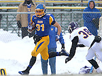 BROOKINGS, SD - NOVEMBER 15: Zach Zenner #31 from South Dakota State University steps past David Griffith #38 from Western Illinois for a touchdown in the second quarter Saturday afternoon at Coughlin Alumni Stadium in Brookings. (Photo by Dave Eggen/Inertia)