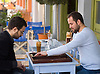 Over frappé at the Acropol cafe in the Thisseio neighborhood of Athens, Greece, two men play a game of backgammon. Photo by Kevin J. Miyazaki/Redux