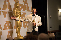 Jordan Peele backstage with the Oscar&reg; for original screenplay for work on &ldquo;Get Out&rdquo; during the live ABC Telecast of the 90th Oscars&reg; at the Dolby&reg; Theatre in Hollywood, CA on Sunday, March 4, 2018.<br /> *Editorial Use Only*<br /> CAP/PLF/AMPAS<br /> Supplied by Capital Pictures