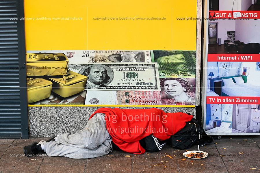 GERMANY, Hamburg, Corona Virus, COVID-19, closed shops on Reeperbahn, St. Pauli red light district, sleeping homeless person infront of money exchange shop