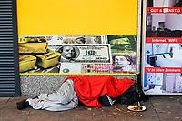 GERMANY, Hamburg, Corona Virus, COVID-19, closed shops on Reeperbahn, St. Pauli red light district, sleeping homeless person infront of money exchange shop