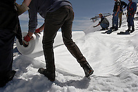 "Workers unwrapped rolls of the material and attached it to the top of the part of the glacier.  Brunnenkogel Ferner--(Austrian word for glacier )is being wrapped with a fleece-like cover to keep it from melting.  The parts covered melt slower than if not covered. The ski area at 3,400 meters is covered by the thirteen workers to help save the ski industry since the glacier is retreating.  The cost of materials is one Euro per square meter.<br /> The Alpine glaciers -- in Austria, Switzerland, France and Italy -- are losing one percent of their mass every year and, even supposing no acceleration in that rate, will have all but disappeared by the end of the century...More hot, dry summers like that of 2003 in Europe, when the loss speeded to five percent, could cut the life expectancy to no more than 50 years, according to Wilfried Haeberli of the University of Zurich.<br /> ""We estimate that by the end of the 21st century, with a medium-type climate scenario, about five percent of what existed in the 1970s will have survived, he added."