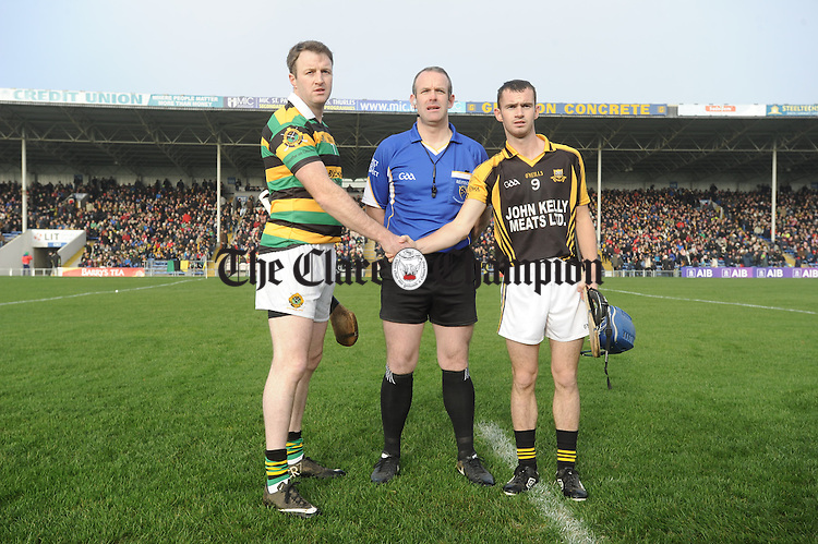 Captain of Ballyea Pearse Stan Lineen  and captain of Glen Rovers Graham Callanan with referee Johnny Murphy before their Munster Club hurling final at Thurles. Photograph by John Kelly.