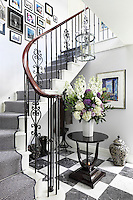 The space under the stairs in the entrance hall is large enough to house a coat stand and boots whilst not erring from the stylish, Georgian aesthetic