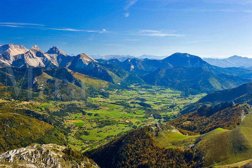 View from the slopes of Mt. Jocou, Drome, over the Upper Buech Valley towards Lus la Croix Haute, le Pic de Bure and Montagne d?Aurouze, Isere. France.