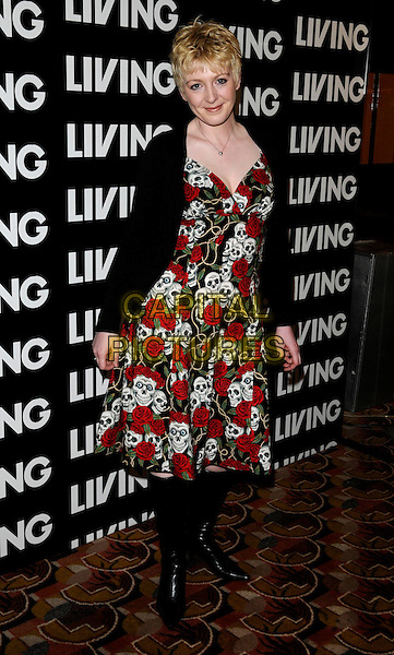 YVETTE FIELDING.Attending the Living TV Summer Schedule Launch event at China Tang, Park Lane, London, England, UK,. May 14th 2008.full length black cardigan boots red rose skull print dress .CAP/CAN.©Can Nguyen/Capital Pictures