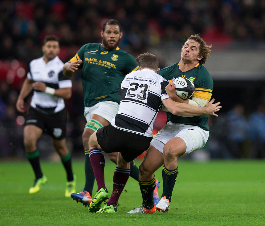 Ruan Janse van Rensburg of South Africa is tackled by Luke Morahan of the Barbarians    Photographer Craig Mercer/CameraSport<br /> <br /> International Rugby Union Friendly - Barbarians v South Africa - Saturday 5th November 2016 - Wembley Stadium - London<br /> <br /> World Copyright &copy; 2016 CameraSport. All rights reserved. 43 Linden Ave. Countesthorpe. Leicester. England. LE8 5PG - Tel: +44 (0) 116 277 4147 - admin@camerasport.com - www.camerasport.com