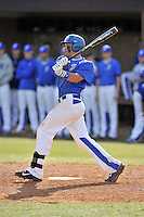 Third baseman Chris Burgess (19) of the Spartanburg Methodist College Pioneers hits in a junior college game against Surry Community College on January 31, 2016, at Mooneyham Field in Spartanburg, South Carolina. (Tom Priddy/Four Seam Images)