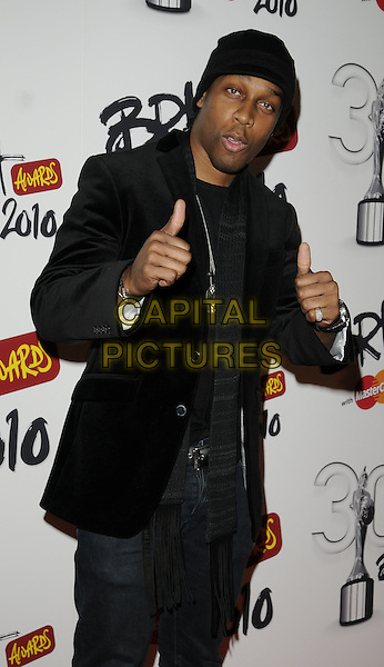 LEMAR aka Lemar Obika.Brit Awards Nominations at Indigo O2, London, England, UK, .January 18th 2010.brits half length black jacket jeans denim hat hands thumbs up.CAP/CAN.©Can Nguyen/Capital Pictures
