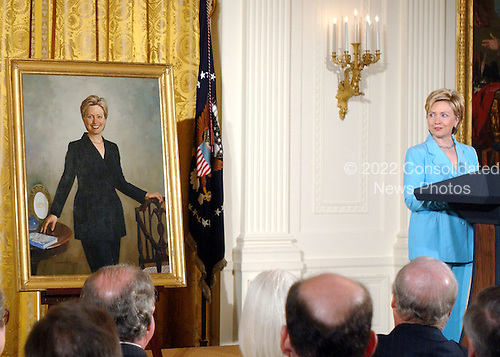 United States Senator Hillary Rodham Clinton (Democrat of New York) makes remarks at the White House ceremony where her portrait and that of her husband, former United States President Bill Clinton, were unveiled at the White House in Washington, D.C. on June 14, 2004.  .Credit: Ron Sachs / CNP