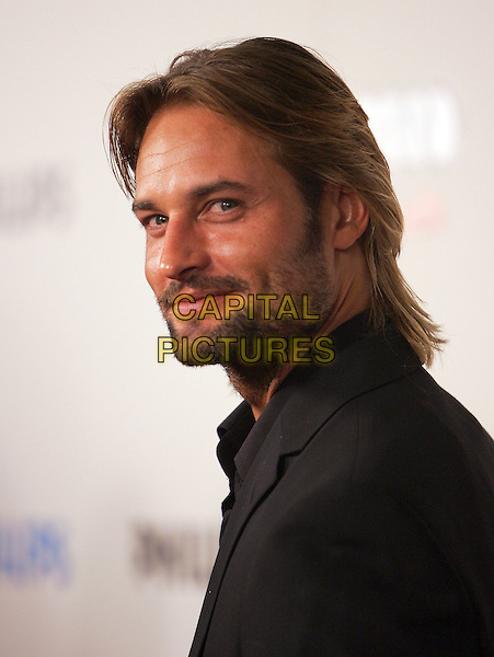 "JOSH HOLLOWAY.The Sony Picture Classics' Premiere of ""William Shakespeare's The Merchant of Venice"" which was part of the AFI Fest 2004 held at The Cinerama Dome in Hollywood, California .November 9th, 2004.headshot, portrait, stubble, facial hair.www.capitalpictures.com.sales@capitalpictures.com.©Debbie Van Story/Capital Pictures"