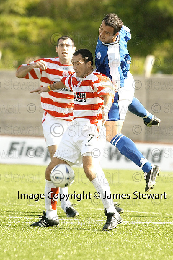04/09/2004   Copyright Pic : James Stewart.File Name : jspa01_hamilton_v_stjohnstone.DAVID HANNAH JUMPS ON THE BACK OF DEREK FERGUSON.....Payments to :.James Stewart Photo Agency 19 Carronlea Drive, Falkirk. FK2 8DN      Vat Reg No. 607 6932 25.Office     : +44 (0)1324 570906     .Mobile  : +44 (0)7721 416997.Fax         :  +44 (0)1324 570906.E-mail  :  jim@jspa.co.uk.If you require further information then contact Jim Stewart on any of the numbers above.........