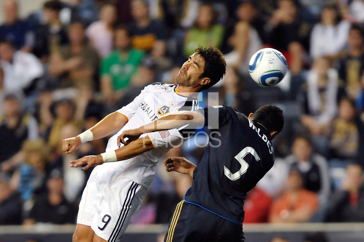 Juan Pablo Angel (9) of the Los Angeles Galaxy and Carlos Valdes (5) of the Philadelphia Union go up for a header. The Philadelphia Union  and the Los Angeles Galaxy played to a 1-1 tie during a Major League Soccer (MLS) match at PPL Park in Chester, PA, on May 11, 2011.