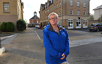 BNPS.co.uk (01202 558833)<br /> Pic: ZacharyCulpin/BNPS<br /> <br /> Tina Cooper at the scene of the tragic accident in  Poundbury.<br /> <br /> Prince Charles' Duchy of Cornwall  has been accused of defying a coroner after he raised concerns about the safety of the roads in Prince Charles' designer village following the death of a motorcyclist.Dorset Assistant Coroner Brendan Allen wrote to the Duchy of Cornwall calling on them to take 'urgent action' after Richard Hallett, 25, was killed after colliding with a van in Poundbury, Dorset.The inquest heard both parties were travelling at low speed and there was 'a lack of road markings and sightlines' at the fatal junction. Charles' utopian idyll has been specifically designed with winding streets and blind bends to calm traffic, instead of conventional stop signs.Mr Allen, in his report, said the evidence he heard 'gave rise to concern' and that the Duchy of Cornwall must act 'to prevent future deaths'. But he has since received a response from them claiming there is no evidence of a 'clustering of accidents' or 'black spots' in Poundbury.Mr Hallett's mother, Tina Cooper, claimed the Duchy of Cornwall's aversion to road signs demonstrated they put 'the prettiness of the town' above saving lives.