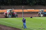 Berwick Rangers 5 East Stirlingshire 0, 23/08/2014. Shielfield Park, Scottish League Two. A groundsman starts the process of making Shielfield Park ready for a professional speedway match shortly after the conclusion of the Scottish League Two fixture between Berwick Rangers and East Stirlingshire. The home club occupied a unique position in Scottish football as they are based in Berwick-upon-Tweed, which lies a few miles inside England. Berwick won the match by 5-0, watched by a crowd of 509. Photo by Colin McPherson.