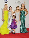 LOS ANGELES, CA - SEPTEMBER 23: Julie Bowen, Ariel Winter, Aubrey Anderson-Emmons, Sarah Hyland and Sofía Vergara pose in the press room at the 64th Primetime Emmy Awards held at Nokia Theatre L.A. Live on September 23, 2012 in Los Angeles, California.