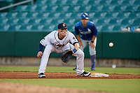 New Orleans Baby Cakes first baseman Matt Snyder (33) stretches for a throw during a Pacific Coast League game against the Oklahoma City Dodgers on May 6, 2019 at Shrine on Airline in New Orleans, Louisiana.  New Orleans defeated Oklahoma City 4-0.  (Mike Janes/Four Seam Images)