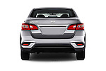 Straight rear view of 2016 Nissan Sentra S 4 Door Sedan Rear View  stock images