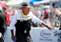 Jul. 17, 2010; Sonoma, CA, USA; NHRA chief starter Rick Stewart during qualifying for the Fram Autolite Nationals at Infineon Raceway. Mandatory Credit: Mark J. Rebilas-
