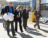 ?, Laura Reed (Maine), Spencer Abbott (Maine) and Jack Connolly (UMD) head for the bus. - The members of the Hobey Hat Trick take a bus to MacDill Air Force Base from Channelside Bay Plaza for the award ceremony on Friday, April 6, 2012, in Tampa, Florida.