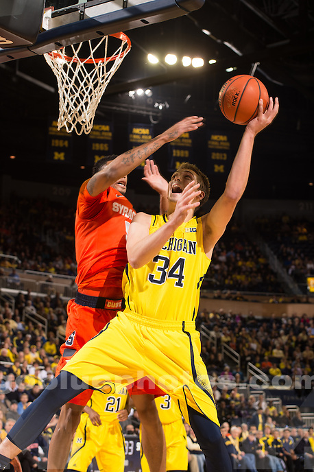 The University of Michigan men's basketball team defeats Syracuse, 68-65, at Crisler Arena in Ann Arbor on Dec. 2, 2014.