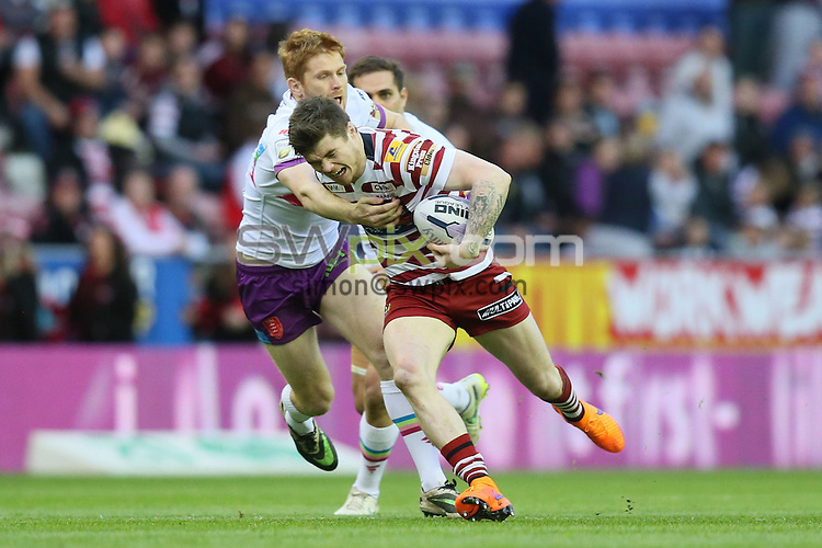 Picture by Paul Currie/SWpix.com - 01/05/2015 - Rugby League - First Utility Super League - Wigan Warriors v Hull Kingston Rovers- DW Stadium, Wigan, England - Wigan Warriors John Bateman is tackled by Hull Kr's Kris Welham