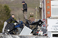 Pictured: Two men load items that were destroyed in the flood onto a truck. Monday 17 February 2020<br /> Re: Cleanup after storm Dennis in Nantgarw, Wales, UK.