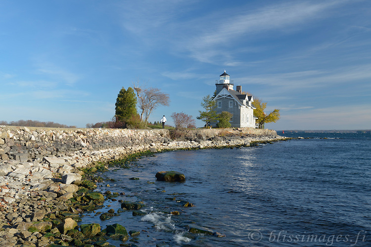 Sisters Island Lighthouse is located on the American side of the St. Lawrence River in the 1000 Islands. It was built on the easternmost island of an original trio of islets called The Three Sisters which are now connected by breakwalls and walkways. The string of islets run parallel to and just south of the international boundary line separating the United States and Canada.