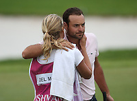 An embrace from caddie girlfriend for Carlos Del Moral (ESP) as he maintains his T3 position after Round Three of The Tshwane Open 2014 at the Els (Copperleaf) Golf Club, City of Tshwane, Pretoria, South Africa. Picture:  David Lloyd / www.golffile.ie