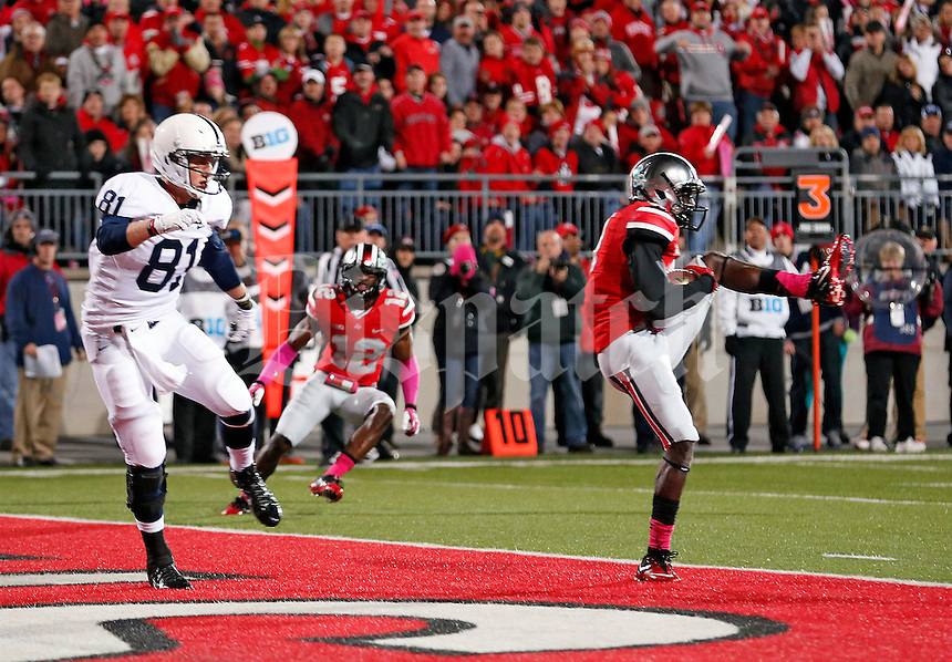 Ohio State Buckeyes defensive back Corey Brown (3) makes an interception in front of Penn State Nittany Lions tight end Adam Breneman (81) during the 1st quarter at Ohio Stadium on October 26, 2013.  (Dispatch photo by Kyle Robertson)