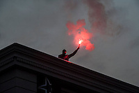 Kurds and anti fascists take to the streets of Hamburg for a 'Shoulder to Shoulder against Fascism ' protest against the persecution of Kurds by fascists and Islamic State and the role of German foriegn policy. 11-9-15 Flares are lit on the roof of a squat.