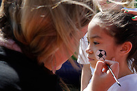 Gemma Perez 9.5yrs. of Parkridge gets her face painted by Cristina Miller before the game. The Los Angeles Sol defeated Sky Blue FC 2-0 during a Women's Professional Soccer match at TD Bank Ballpark in Bridgewater, NJ, on April 5, 2009. Photo by Howard C. Smith/isiphotos.com