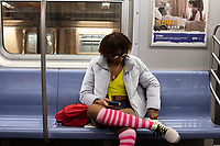 NEW YORK, NY - JANUARY 12: A woman takes part in the No Pants Subway Ride at the NYC subway system on January 12, 2020 in New York. The annual event, in which participants board a subway car in January while not wearing any pants while behaving as though they do not know each other, began as a joke by the public prank group Improv Everywhere in New York City and has since spread around the world, with enthusiasts in around 60 cities and 29 countries across the globe, according to the organization's site.   (Photo by Joana Toro/VIEWpress)