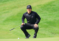 Thorbjorn Olesen (DEN) lines up his putt on the 9th green during Sunday's Final Round of the 2014 BMW Masters held at Lake Malaren, Shanghai, China. 2nd November 2014.<br /> Picture: Eoin Clarke www.golffile.ie