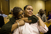 Denise Spivey holds onto her sister, Karen Daniel, as Durham Superior Court Judge Orlando Hudson dismisses all charges against Karen's son, Erick Daniels, who has served seven years in prison for a robbery he did not commit, Friday, Sept. 19, 2008..