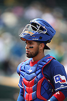 OAKLAND, CA - MAY 15:  Robinson Chirinos #61 of the Texas Rangers walks back to the dugout during the game against the Oakland Athletics at O.co Coliseum on Wednesday May 15, 2013 in Oakland, California. Photo by Brad Mangin