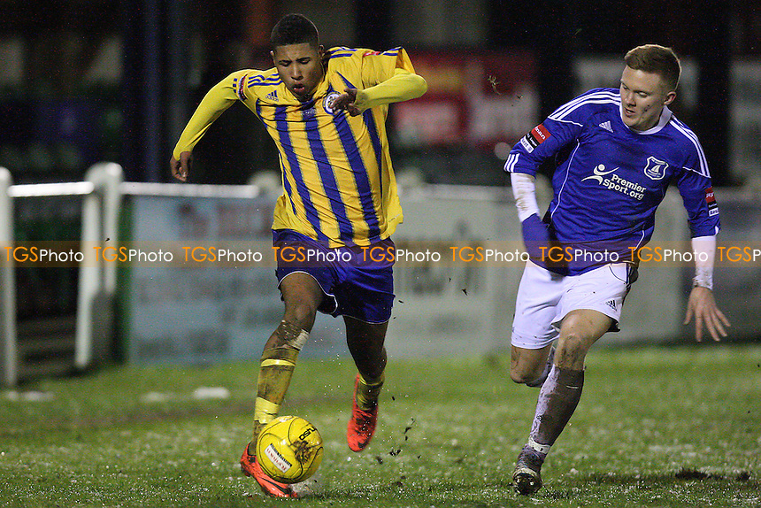 Lewis Francis of Romford and Matthew Daniels of Wroxham - Wroxham vs Romford - Ryman League Division One North Football at Trafford Park - 05/02/13 - MANDATORY CREDIT: Gavin Ellis/TGSPHOTO - Self billing applies where appropriate - 0845 094 6026 - contact@tgsphoto.co.uk - NO UNPAID USE.